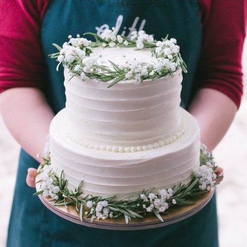 Two Tier White Striped Cake with Rosemary and Baby's Breath